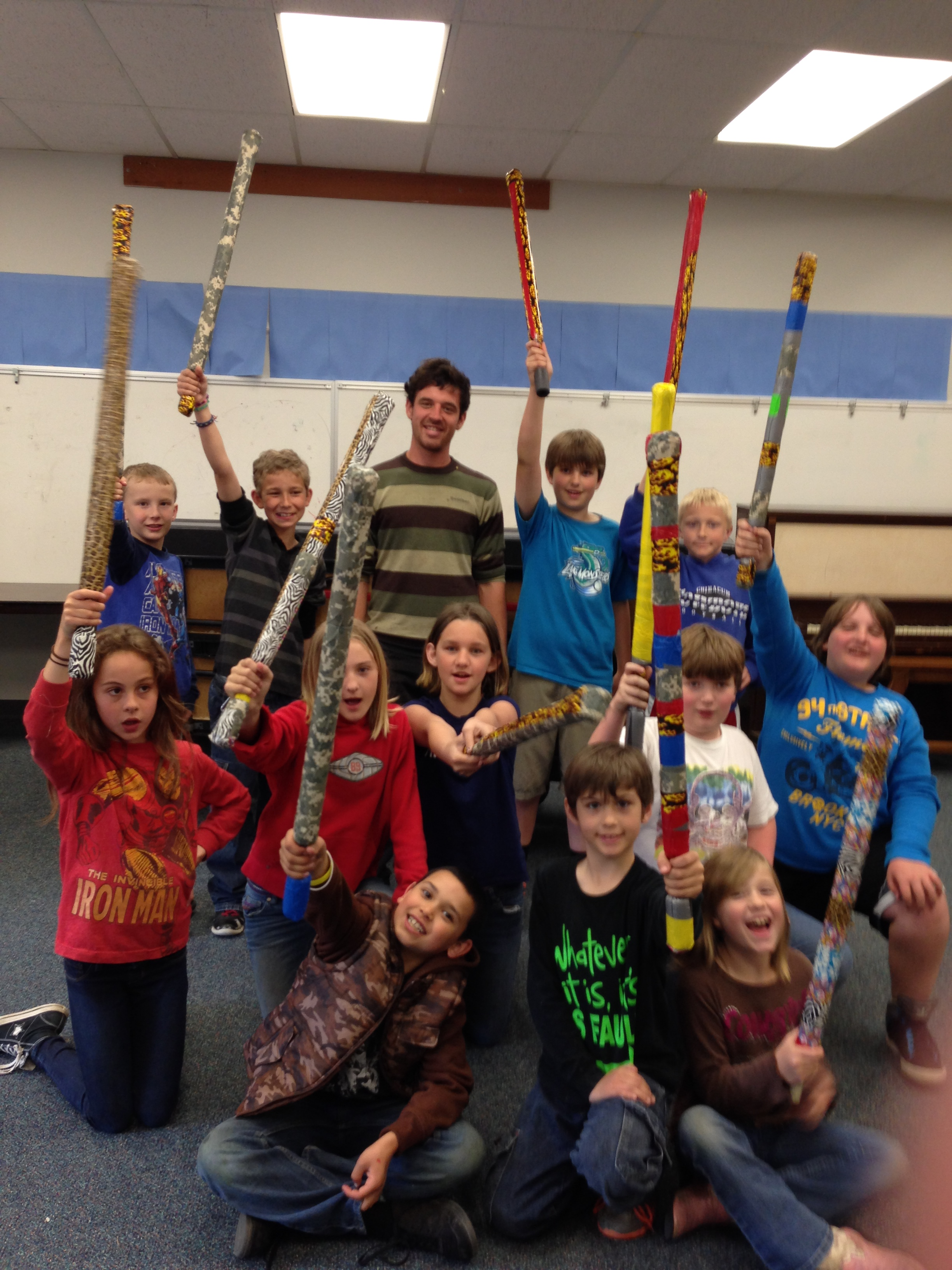 Group of teens wielding play swords