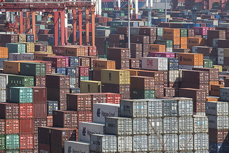 Image of many shipping containers stacked upon one another